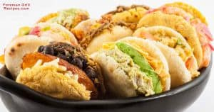 Various stuffed arepas in foreman grill